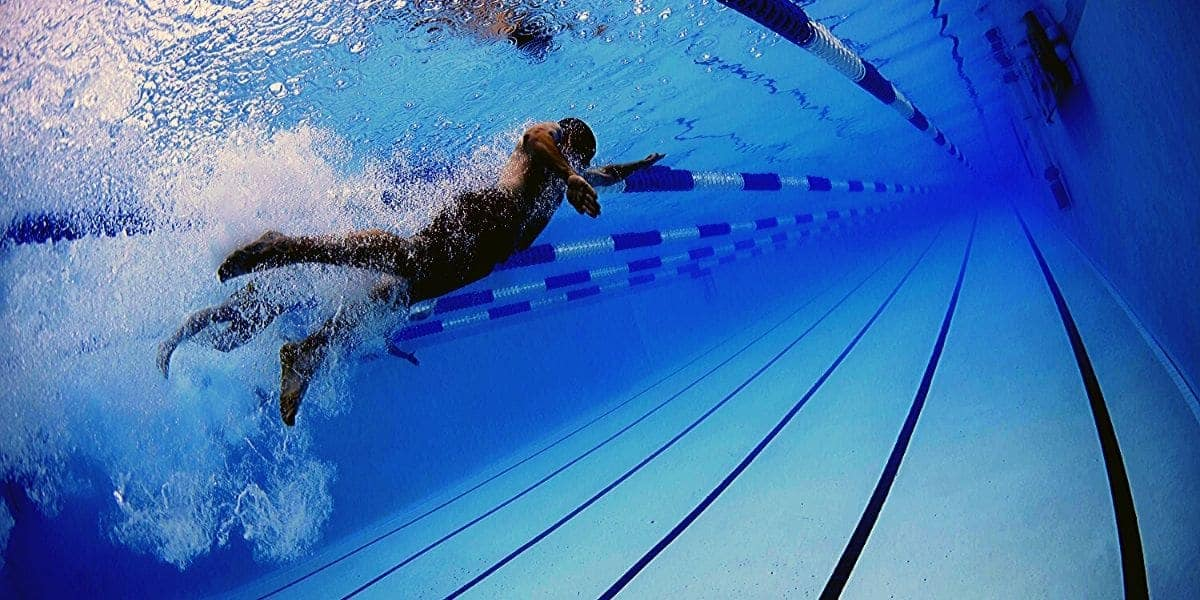 Swimmer with a freestyle tech suit