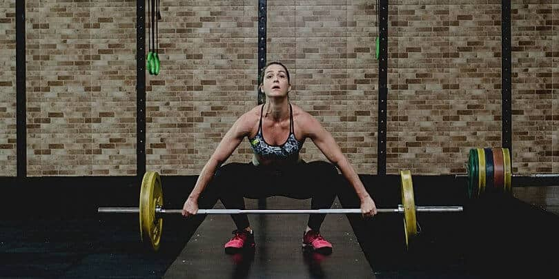 distance swimmer doing weight training in the gym