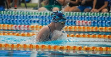 Swimmer wearing a TYR tech suit