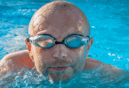 Swimmer wearing a pair of prescription swim goggles